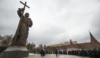 In this photo taken on Friday, Nov. 4, 2016, Russian President Vladimir Putin speaks at the unveiling ceremony of a monument to Vladimir the Great, who is credited with making Orthodox Christianity the official faith of Russia, Ukraine and Belarus, on the National Unity Day outside the Kremlin in Moscow, Russia. When Alexander Zemlianichenko started working as an AP photographer in Moscow, the Soviet Union was nearing its demise. (AP Photo/Alexander Zemlianichenko, file)