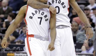 Toronto Raptors' Kyle Lowry (7) celebrates with teammate DeMar DeRozan (10) after scoring in the second half during an NBA basketball game against the Utah Jazz, Friday, Dec. 23, 2016, in Salt Lake City. (AP Photo/Rick Bowmer)