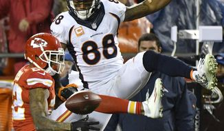 Kansas City Chiefs defensive back Marcus Peters (22) breaks up a pass intended for Denver Broncos wide receiver Demaryius Thomas (88) during the second half of an NFL football game in Kansas City, Mo., Sunday, Dec. 25, 2016. (AP Photo/Ed Zurga)