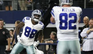 Dallas Cowboys' Dez Bryant (88) celebrates after throwing a pass for a touchdown to tight end Jason Witten (82) in the second half of an NFL football game against the Detroit Lions on Monday, Dec. 26, 2016, in Arlington, Texas. (AP Photo/Brandon Wade)