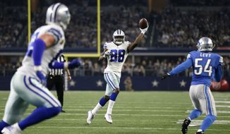 Dallas Cowboys wide receiver Dez Bryant (88) throws a touchdown pass to tight end Jason Witten, let in the end zone as Detroit Lions' DeAndre Levy (54) defends in the second half of an NFL football game, Monday, Dec. 26, 2016, in Arlington, Texas. (AP Photo/Brandon Wade)