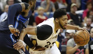 New Orleans Pelicans forward Anthony Davis (23) drives past Dallas Mavericks guard Wesley Matthews (23) in the first half of an NBA basketball game in New Orleans, Monday, Dec. 26, 2016. (AP Photo/Tyler Kaufman)