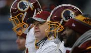 Washington Redskins head coach Jay Gruden watches during the second half of an NFL football game against the Chicago Bears, Saturday, Dec. 24, 2016, in Chicago. (AP Photo/Charles Rex Arbogast) **FILE**