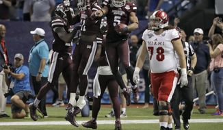Mississippi State defensive back Cedric Jiles (5) celebrates with teammates as he holds the football after recovering a blocked field goal by Miami (Ohio) place kicker Nick Dowd as Miami (Ohio) lineman Ian Leever (78) walks away during the second half of the St. Petersburg Bowl NCAA college football game Monday, Dec. 26, 2016, in St. Petersburg, Fla. Mississippi State won the game 17-16. (AP Photo/Chris O'Meara)