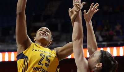 FILE- In this June 5, 2016, file photo, Indiana Fever's Marissa Coleman, left, shoots over Connecticut Sun's Kelly Faris, right, during the second half of a WNBA basketball game in Uncasville, Conn. The WNBA is offering a security app to its players to help them stay safer while they are overseas this offseason. Coleman is in her third offseason playing in Turkey. Last January, she left the area near the Blue Mosque in Istanbul moments before a suicide bombing occurred there. (AP Photo/Jessica Hill, File)