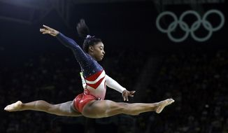 FILE - In this Aug. 9, 2016 file photo, United States' Simone Biles performs on the balance beam during the artistic gymnastics women's team final at the Summer Olympics in Rio de Janeiro, Brazil. Briles was selected as the AP Female Athlete of the Year, on Monday, Dec. 26, 2016. (AP Photo/Rebecca Blackwell, File)
