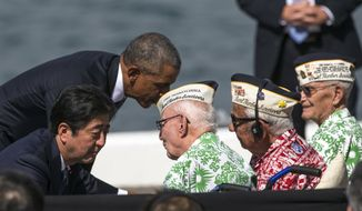 Japanese Prime Minister Shinzo Abe and U.S. President Barack Obama speaks with Pearl Harbor veterans Sterling Cale, from left, Al Rodrigues and Everett Hyland at Joint Base Pearl Harbor-Hickam, Tuesday, Dec. 27, 2016, in Honolulu. Abe and Obama made a historic pilgrimage Tuesday to the site where the devastating surprise attack sent America marching into World War II. (AP Photo/Marco Garcia)