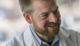 This Monday, Dec. 19, 2016 photo, shows Dr. Kent Brantly, who was infected with Ebola in Liberia, in Fort Worth, Texas. The Fort Worth Star-Telegram reported that Brantly returned to practicing medicine about a year ago. He now practices medicine and teaches young doctors at JPS Health Network, where he said some patients recognize him and bring up his battle of more than two years ago. (Rodger Mallison/Star-Telegram via AP)
