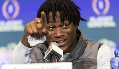 Alabama linebacker Reuben Foster (10) indicates the TV cameras after a reporter jokingly promised not to tell anyone if Foster shared any funny info about Alabama defensive lineman Jonathan Allen, who was in the other press room, during the Alabama defensive press conference for the Peach Bowl, Tuesday, Dec. 27, 2016, at Hyatt Regency Atlanta in Atlanta, Ga.  (Vasha Hunt/AL.com via AP)