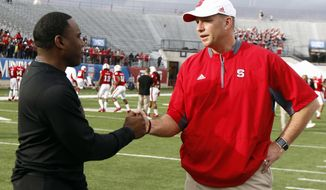 Vanderbilt football coach Derek Mason, left, and North Carolina State coach Dave Doeren shake hands before the Camping World Independence Bowl NCAA college football game in Shreveport, La., Monday, Dec. 26, 2016. (AP Photo/Rogelio V. Solis)