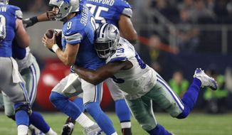 Detroit Lions quarterback Matthew Stafford (9) is sacked by Dallas Cowboys defensive end Benson Mayowa in the second half of an NFL football game, Monday, Dec. 26, 2016, in Arlington, Texas. (AP Photo/Brandon Wade)