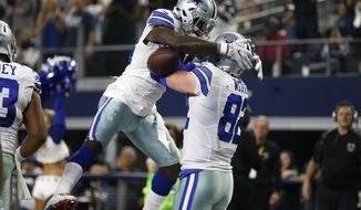 Dallas Cowboys' Dez Bryant (88) celebrates with tight end Jason Witten (82) after Bryant threw a touchdown pass to Witten in the in the second half of an NFL football game against the Detroit Lions on Monday, Dec. 26, 2016, in Arlington, Texas. (AP Photo/Brandon Wade)