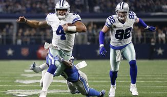 Detroit Lions' Johnson Bademosi, brings down Dallas Cowboys' Dak Prescott (4) after a short run as tight end Jason Witten watches in the second half of an NFL football game, Monday, Dec. 26, 2016, in Arlington, Texas. (AP Photo/Brandon Wade)