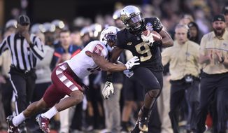 Wake Forest wide receiver Chuck Wade catches a pass as Temple cornerback Artrel Foster pursues during the first half of the Military Bowl NCAA college football game, Tuesday, Dec. 27, 2016 in Annapolis, Md. (AP Photo/Gail Burton)