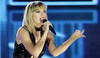 """FILE - In this Oct. 22, 2016 photo, Taylor Swift performs in Austin, Texas. Ninety-six-year-old Cyrus Porter is a devoted Taylor Swift fan and has traveled to her shows, but on Monday, Dec. 26 2016, he didn't have to go anywhere, Swift came to him. Swift had learned about the World War II combat veteran's fandom and decided to surprise him. A day after Christmas a van carrying Swift pulled into the driveway of his home in New Madrid, Mo. The singer stayed about an hour and sang """"Shake It Off"""" as Porter's relatives sang along. (AP Photo/Darron Cummings, File)"""