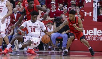 Wisconsin's Nigel Hayes (10) and Rutgers' Candido Sa, right, go after a loose ball during the first half of an NCAA college basketball game Tuesday, Dec. 27, 2016, in Madison, Wis. (AP Photo/Andy Manis)
