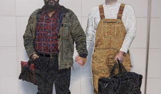 In this Nov. 29, 2016 photo provided by the New York Metropolitan Transportation Authority, a mural on the wall of the Second Avenue Subway station at 72nd Street, in New York, shows Thor Stockman, left, and his husband, Patrick Kellogg. (New York Metropolitan Transportation Authority via AP)