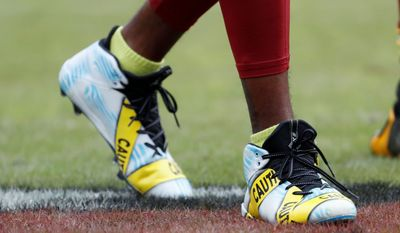 Washington Redskins receiver DeSean Jackson wore cleats with yellow police tape on them during warm ups on Oct. 2 to speak up against violence.