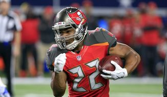 This Dec. 18, 2016 photo shows Tampa Bay Buccaneers' Doug Martin (22) carrying the ball in the first half of an NFL football game against the Dallas Cowboys in Arlington, Texas. Martin has been suspended four games for violating the NFL's policy on performance enhancing substances and said Wednesday, Dec. 28, 2016 he's entering a treatment facility rather than appeal the ban. (AP Photo/Ron Jenkins)