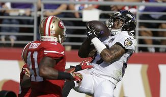 FILE - In this Oct. 18, 2015, file photo, Baltimore Ravens wide receiver Steve Smith (89) catches a 34-yard touchdown pass in front of San Francisco 49ers strong safety Antoine Bethea (41) and cornerback Kenneth Acker during the second half of an NFL football game in Santa Clara, Calif. Smith intended to retire at the end of the 2015 season, but  ultimately decided to come back for one more season.  It's unclear if his final game will be Sunday, Jan 1, 2017 in Cincinnati. (AP Photo/Ben Margot,File) **FILE**