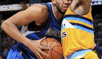 Minnesota Timberwolves center Karl-Anthony Towns (32) is fouled by Denver Nuggets forward Wilson Chandler (21) during the first half of an NBA basketball game Wednesday, Dec. 28, 2016, in Denver. (AP Photo/Jack Dempsey)