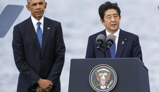 Japanese Prime Minister Shinzo Abe, right, with U.S. President Barack Obama, speaks at Joint Base Pearl Harbor Hickam, Tuesday, Dec. 27, 2016, in Honolulu. Abe and Obama made a historic pilgrimage Tuesday to the site where the devastating surprise attack sent America marching into World War II. (AP Photo/Marco Garcia)