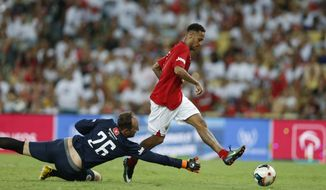 Soccer player Neymar, right, scores a goal during the Game of the Stars charity soccer match in Rio de Janeiro, Brazil, Wednesday, Dec. 28, 2016. This year the game also honored Brazil's Chapecoense soccer team. A chartered plane was carrying Chapecoense to the opening match in the Copa Sudamericana tournament's finals when it crashed outside Medellin on Nov. 28, killing 71 of the 77 people on board. (AP Photo/Silvia Izquierdo)