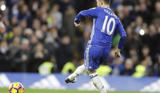 Chelsea's Eden Hazard scores with a penalty kick during the English Premier League soccer match between Chelsea and Bournemouth at Stamford Bridge stadium in London, Monday, Dec. 26, 2016.(AP Photo/Frank Augstein)