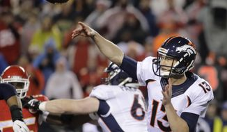 Denver Broncos quarterback Trevor Siemian (13) throws during the first half of an NFL football game against the Kansas City Chiefs in Kansas City, Mo., Sunday, Dec. 25, 2016. (AP Photo/Charlie Riedel)
