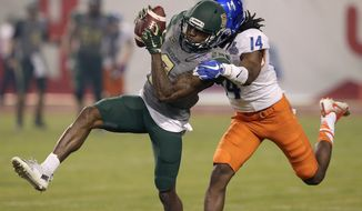Baylor wide receiver KD Cannon (9) pulls in a a pass as Boise State cornerback Tyler Horton (14) defends during the first half of the Cactus Bowl NCAA college football game, Tuesday, Dec. 27, 2016, in Phoenix. (AP Photo/Rick Scuteri)