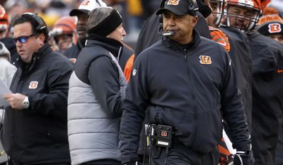 FILE - In this Sunday, Dec. 18, 2016, file photo, Cincinnati Bengals head coach Marvin Lewis works the sideline in the first half of an NFL football game against the Pittsburgh Steelers in Cincinnati. Should he stay or should he go? Owner Mike Brown is fond of Lewis, who is under contract through 2017. (AP Photo/Frank Victores, File)