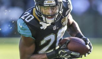 CORRECTS SECOND REFERENCE - In this Saturday, Dec. 24, 2016, photo, Jacksonville Jaguars cornerback Jalen Ramsey returns an interception for a touchdown against the Tennessee Titans during the second half of an NFL football game in Jacksonville, Fla. Ramsey had one thought as he scampered toward his first NFL touchdown: Deion Sanders. (AP Photo/Gary McCullough)