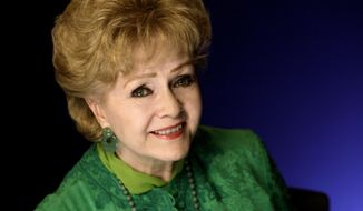 FILE - This Oct. 14, 2011 file photo shows actress Debbie Reynolds posing for a portrait in New York. The Los Angeles Times and celebrity website TMZ have reported that Reynolds has been rushed to the hospital Wednesday, Dec. 28, 2016, after suffering a medical emergency in Los Angeles one day after her daughter Carrie Fisher died. (AP Photo/Richard Drew, File)