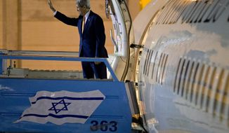 "FILE -- In this Nov. 24, 2015 file photo, U.S. Secretary of State John Kerry waves as he boards the plane on departure from Israel after meetings in Jerusalem and the West Bank city of Ramallah. A senior leader of a Jewish settlement council is calling U.S. Secretary of State John Kerry ""a stain on American foreign policy"" and ""ignorant of the issues."" Oded Revivi, chief foreign envoy of the Yesha Council, made the remarks ahead of Kerry's final policy speech on Mideast peace Wednesday. (AP Photo/Jacquelyn Martin, Pool, File)"
