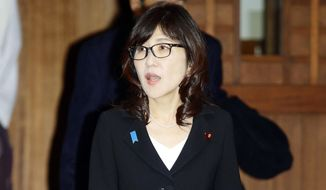 Japan's Defense Minister Tomomi Inada visits Yasukuni Shrine, which honors Japanese war dead, in Tokyo Thursday, Dec. 29, 2016. (Yosuke Mizuno/Kyodo News via AP)