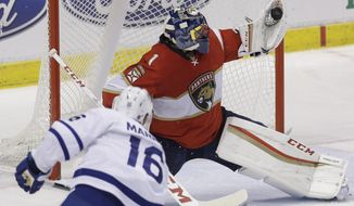 Florida Panthers goalie Roberto Luongo (1) blocks a shot by Toronto Maple Leafs center Mitchell Marner (16) during the second period of an NHL hockey game, Wednesday, Dec. 28, 2016, in Sunrise, Fla. (AP Photo/Alan Diaz)