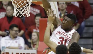 Indiana's Thomas Bryant dunks against Nebraska's Ed Morrow during the first half of an NCAA college basketball game Wednesday, Dec. 28, 2016, in Bloomington, Ind. (AP Photo/Darron Cummings)