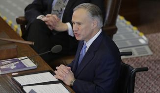 FILE - In this Feb. 17, 2016 file photo, Texas Gov. Greg Abbott, right, delivers his State of the State address to a joint session of the House and Senate in Austin, Texas. Texas Lt. Gov. Dan Patrick is at left. The top two Republican leaders in Texas continue to downplay a possible intraparty battle for governor in 2018, despite Patrick's repeated efforts to move to Abbott's right on key conservative issues. (AP Photo/Eric Gay, File)