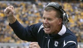FILE - In this Oct. 24, 2009, file photo, Connecticut head coach Randy Edsall, greets a player after his team scored against West Virginia during an NCAA college football game in Morgantown, W.Va. Edsall, who coached UConn from 1999-2010, left for Maryland in 2011 and was fired midway through his fifth season as Maryland's head coach. UConn announced Wednesday, Dec. 28, 2016, that Edsall has agreed to return as Connecticut's football coach. He would replace Bob Diaco, who was fired effective Jan. 2, 2017. (AP Photo/Michael Switzer, File)