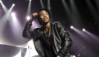 In this March 2, 2015, file photo, Trey Songz performs during the Between The Sheets Tour at Philips Arena in Atlanta. Police say Songz has been arrested for throwing microphones and speakers from the stage during a performance at Joe Louis Arena in Detroit. The Detroit Police Department says Songz, whose real name is Tremaine Neverson, was arrested Wednesday, Dec. 28, 2016, after the show. (Photo by Robb D. Cohen/Invision/AP, File)