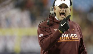 Virginia Tech head coach Justin Fuente tries to fire up his team against Arkansas during the first half of the Belk Bowl NCAA college football game in Charlotte, N.C., Thursday, Dec. 29, 2016. (AP Photo/Bob Leverone)