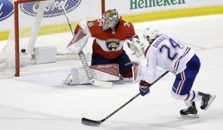 Montreal Canadiens left wing Phillip Danault (24) scores a goal against Florida Panthers goalie James Reimer (34) during overtime of an NHL hockey game, Thursday, Dec. 29, 2016, in Sunrise, Fla. The Canadiens won 3-2 in overtime. (AP Photo/Alan Diaz)