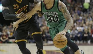 Boston Celtics' Gerald Green (30) drives past Cleveland Cavaliers' LeBron James (23) in the first half of an NBA basketball game, Thursday, Dec. 29, 2016, in Cleveland. (AP Photo/Tony Dejak)