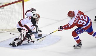 New Jersey Devils goalie Keith Kinkaid (1) stops Washington Capitals center Evgeny Kuznetsov (92), of Russia, during a shootout of an NHL hockey game, Thursday, Dec. 29, 2016, in Washington. The Devils won 2-1 in a shootout. (AP Photo/Nick Wass)