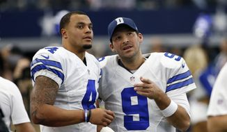 In a Sunday, Nov. 20, 2016, file photo, Dallas Cowboys' Dak Prescott (4) and Tony Romo (9) talk on the sideline in the first half of an NFL football game against the Baltimore Ravens in Arlington, Texas. The Cowboys went on a record-setting run without quarterback Romo, thanks to a pair of star rookies, Dak Prescott and Esekiel Elliott. (AP Photo/Michael Ainsworth, File)