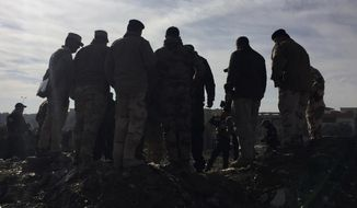 Iraqi army and special forces commanders gather to discuss battle plans in the eastern section of Mosul, Iraq, Thursday, Dec. 29, 2016. Iraqi troops backed by U.S.-led airstrikes pushed deeper into eastern Mosul on Thursday in a multi-pronged assault after a two-week lull in the operation to retake the Islamic State-held city. (AP Photo/Hamza Hendawi)