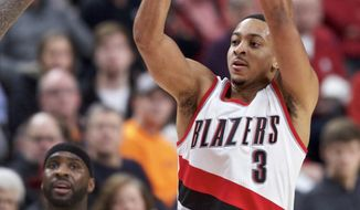 Portland Trail Blazers guard C.J. McCollum, right, shoots over Sacramento Kings guard Ty Lawson during the second half of an NBA basketball game in Portland, Ore., Wednesday, Dec. 28, 2016. (AP Photo/Craig Mitchelldyer)