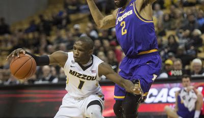 Missouri's Terrence Phillips, left, loses control of the ball in front of Lipscomb's Josh Williams during the first half of an NCAA college basketball game Thursday, Dec. 29, 2016, in Columbia, Mo. (AP Photo/L.G. Patterson)