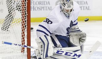 Toronto Maple Leafs goalie Antoine Bibeau makes a save on a shot by the Tampa Bay Lightning during the second period of an NHL hockey game Thursday, Dec. 29, 2016, in Tampa, Fla. (AP Photo/Chris O'Meara)