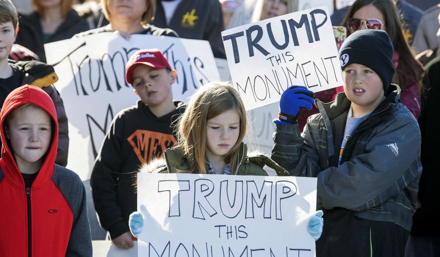 Protesters demonstrate against the new Bears Ear National Monument in Montecello, Utah, Thursday, Dec. 29, 2016. President Barack Obama expanded his environmental legacy in the final days of his presidency with national monument designations on lands in Utah and Nevada that have become flashpoints over use of public land in the U.S. West.  The Bears Ears National Monument in Utah will cover over 1 million acres in the Four Corners region, the White House announced Wednesday.  (Rick Egan/The Salt Lake Tribune via AP)